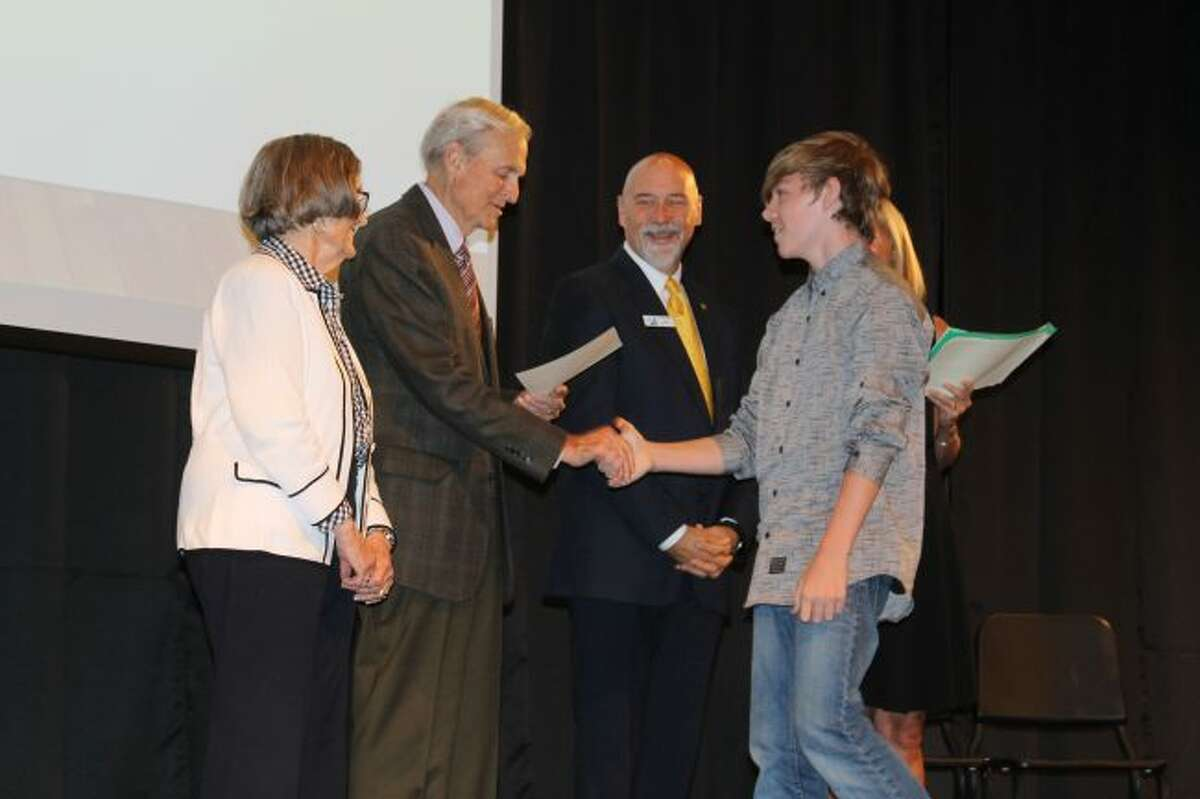 Bill and Marty Paine who are sponsoring the Manistee Commitment Scholarship program congratulate a student who is among the first class of 33 freshmen that are entering the program that could lead to a free college education from West Shore Community College.