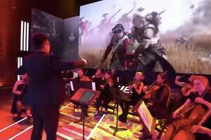 """An orchestra live scoring """"Assassin's Creed."""""""