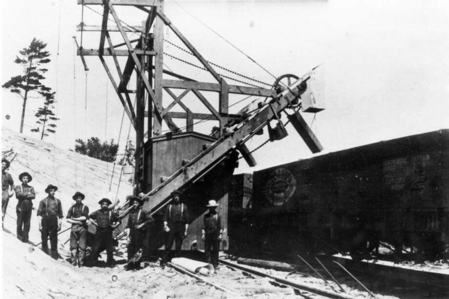 Shown is a sand loader for the Manistee and Grand Rapids Railroad line from the early 1900s.