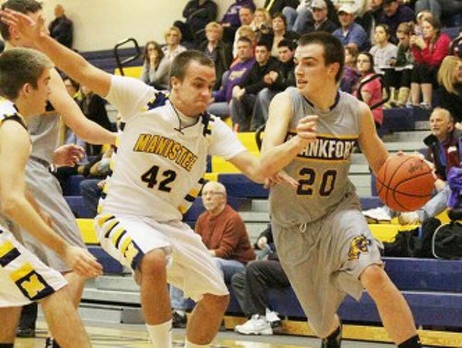 Manistee's Jordan MacArthur (42) defends Frankfort's David Loney during a game on Jan. 15. The Chippewas could join the Panthers in the Northwest Conference under an expansion proposal. (Matt Wenzel/News Advocate file photo)