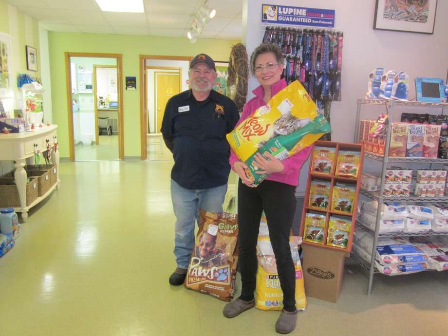 Homeward Bound Board Vice-President Camille Kocsis stands with Roger Betts at Parkdale with some of the food donations. They recently went over 30,000 pounds in donations.(Courtesy photo)