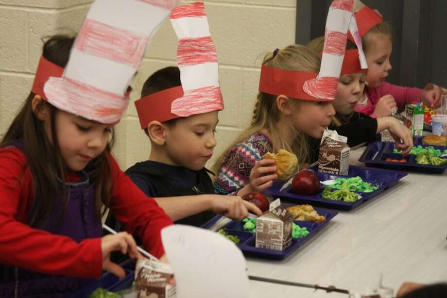 Students at Madison Elementary School try out some green eggs and ham to celebrate reading month and the birthday of Dr. Seuss.