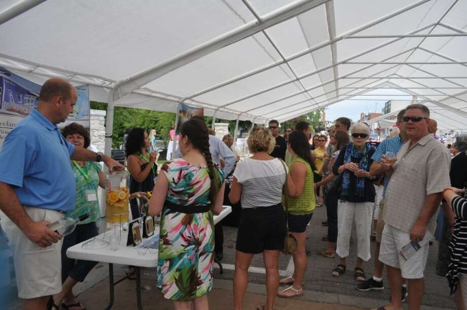 Residents and visitors alike took to the Manistee Municipal Marina on Saturday to taste local food and wines as part of the Manistee Area Chamber of Commerce event Grapes on the River.