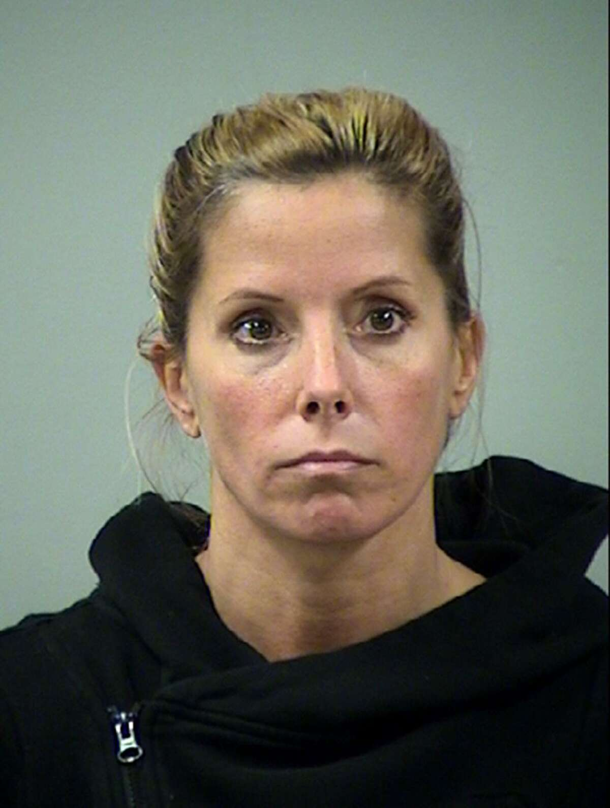 Holly Blakely, then 42, is shown in this mug shot from April 2016. In February, she admitted paying more than $400,000 in kickbacks and bribes to health care providers prescribing compound medications for pain to people who did not need them. She is set to be sentenced Tuesday, July 30.