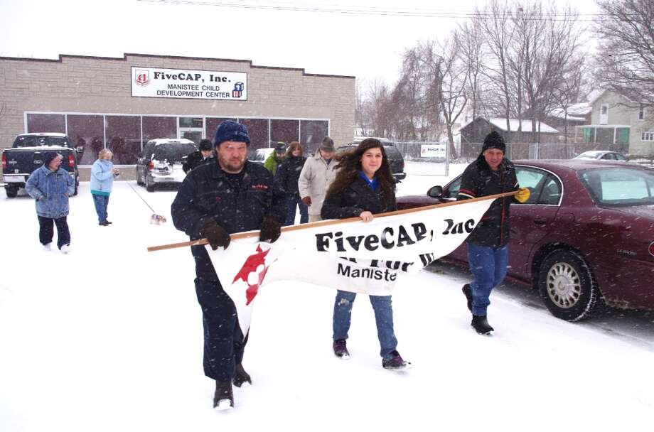 Like for the 2012 Walk for Warmth, there should be plenty of snow on the ground for the 2013 edition of the fundraiser, that starts Saturday at 10 a.m. at the FiveCAP office, 265 First St., Manistee. (News Advocate File Photo)