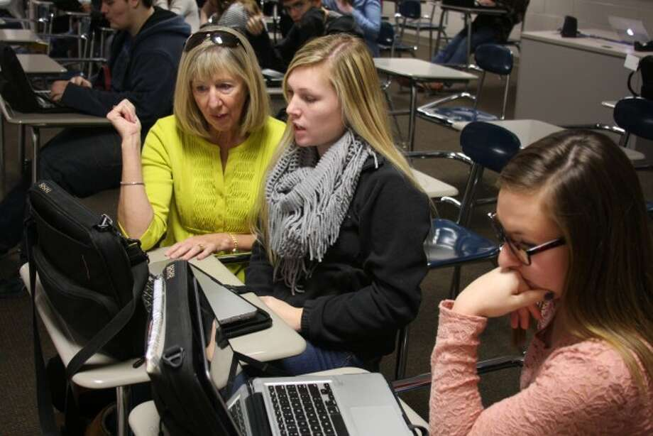 Launch Manistee program coordinator Mary Ann Behm talks with students during college application week. The program has been having good success in assisting Manistee County students to succeed in their schooling from cradle to career.