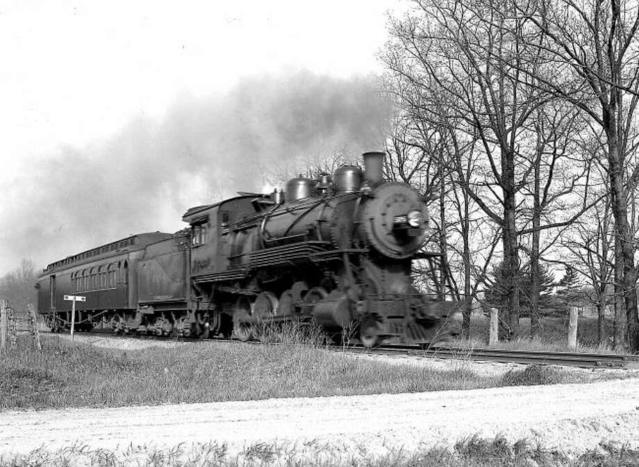 An M & NE train races down the tracks in Manistee County in this 1930s photograph.
