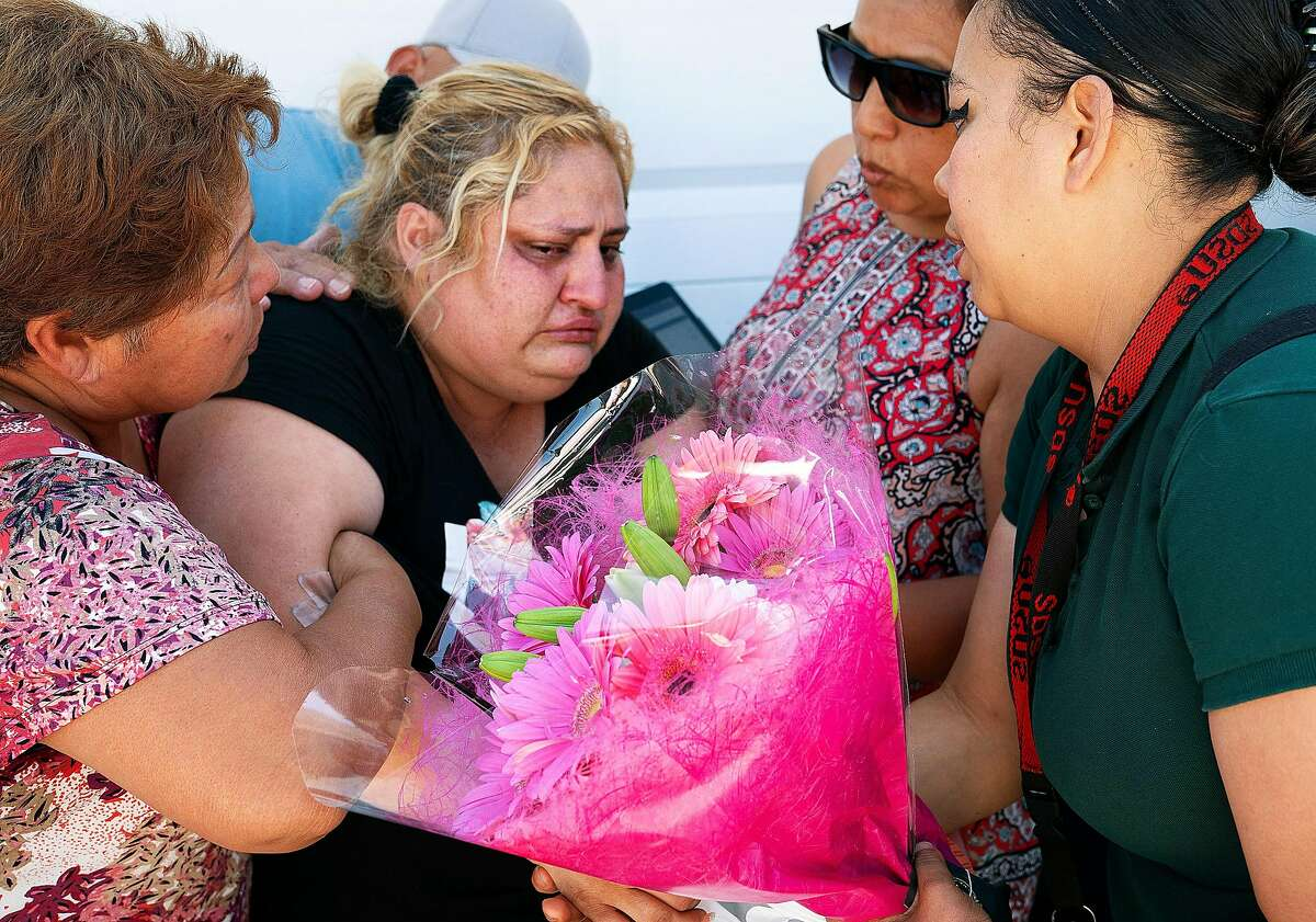 Lorena Pimentel,, center, whose daughter Keyla Salazar was killed during the shooting at the Gilroy Garlic Festival, is comforted by friends and family at her house in San Jose, Calif., on Monday, July 29, 2019.