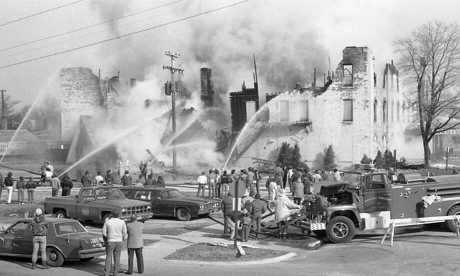 Onlookers gaze as firefighters battle the flames that destroyed the former Hotel Chippewa on March 26, 1985.