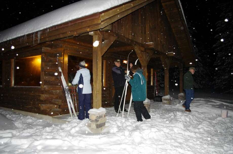 Skiers get ready to go into the Big M Lodge to enjoy warmth and refreshments. (Dave Yarnell/News Advocate)