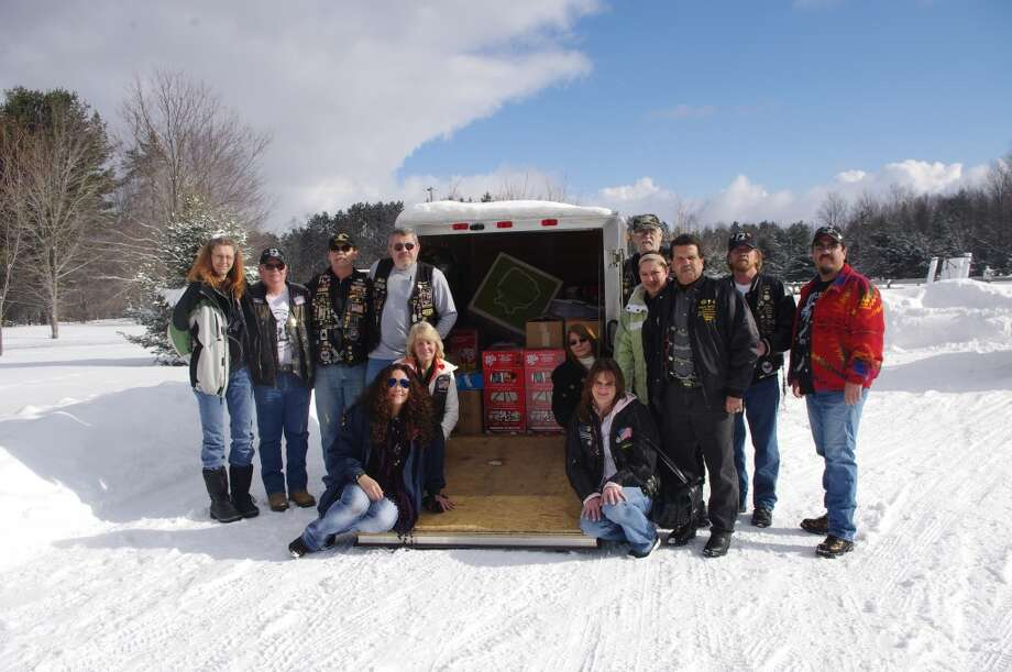 A large number of representatives from Manistee's Rolling Thunder Michigan Chapter One made the trip Sunday to Gaylord to present a trailer full of items to the Patriot Place facility for homeless veterans. From left to right are Lori Welch, Jim Defever, Mitchell Smith, Jerry Langhann, Kelly Trudell, , Linda Stocki, Starla Owens (a Gold Star mother), Brenda Wilson, Rev. Doug Welch, Amber Brave Bull, Calvin Murphy, Marty Kensil and Bo-John Brave Bull. (Dave Yarnell/News Advocate)