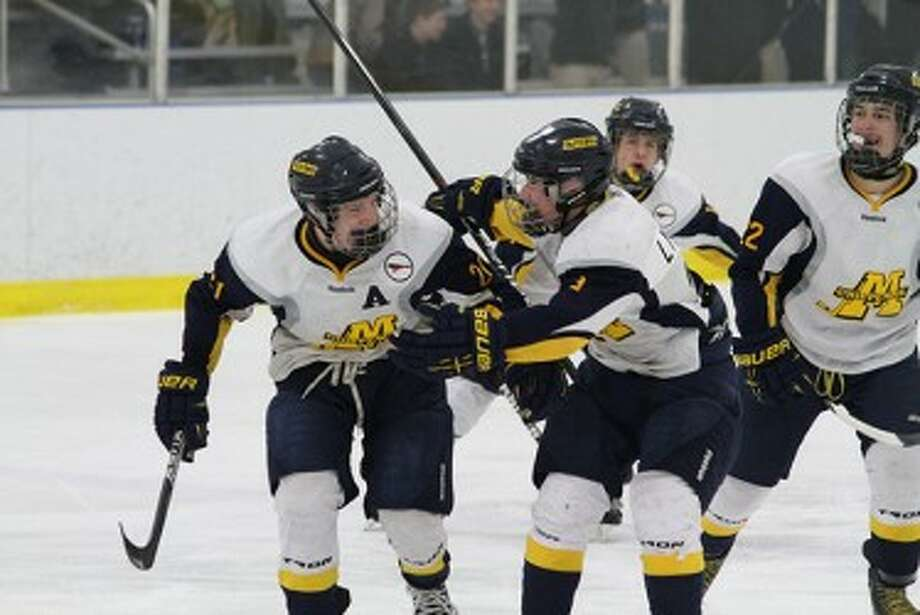 Manistee senior Keegan Nowaczyk (left) celebrates his go-ahead goal with teammate Yari Lynch during the third period of Saturday's win against Jenison at West Shore Community Ice Arena. (Matt Wenzel/News Advocate)