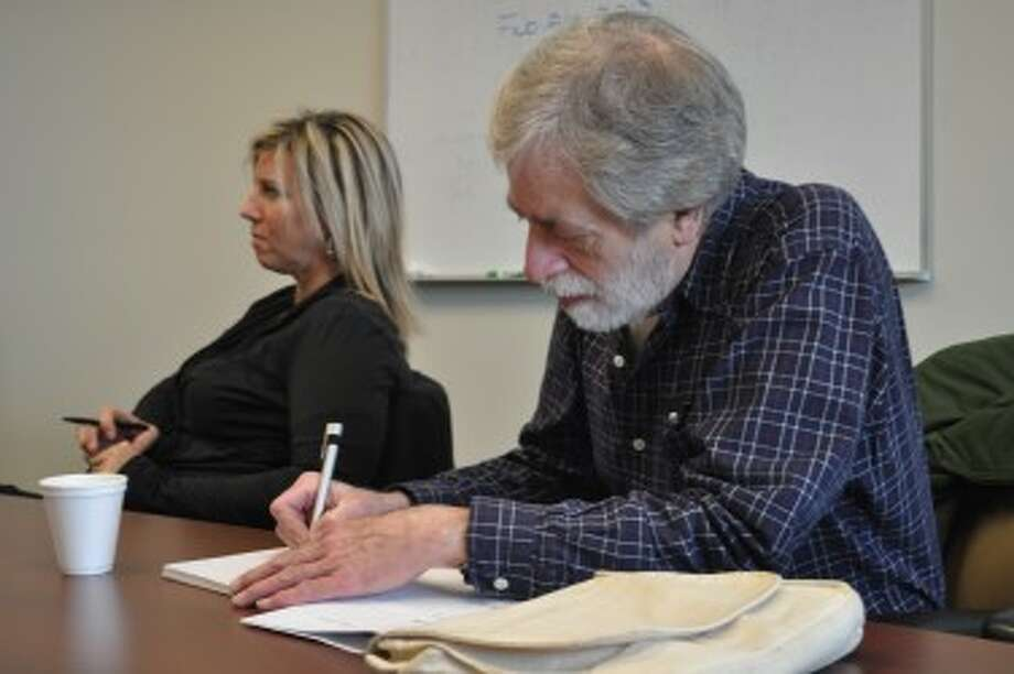 Mark Lough, workshop attendee, takes notes during the presentation.