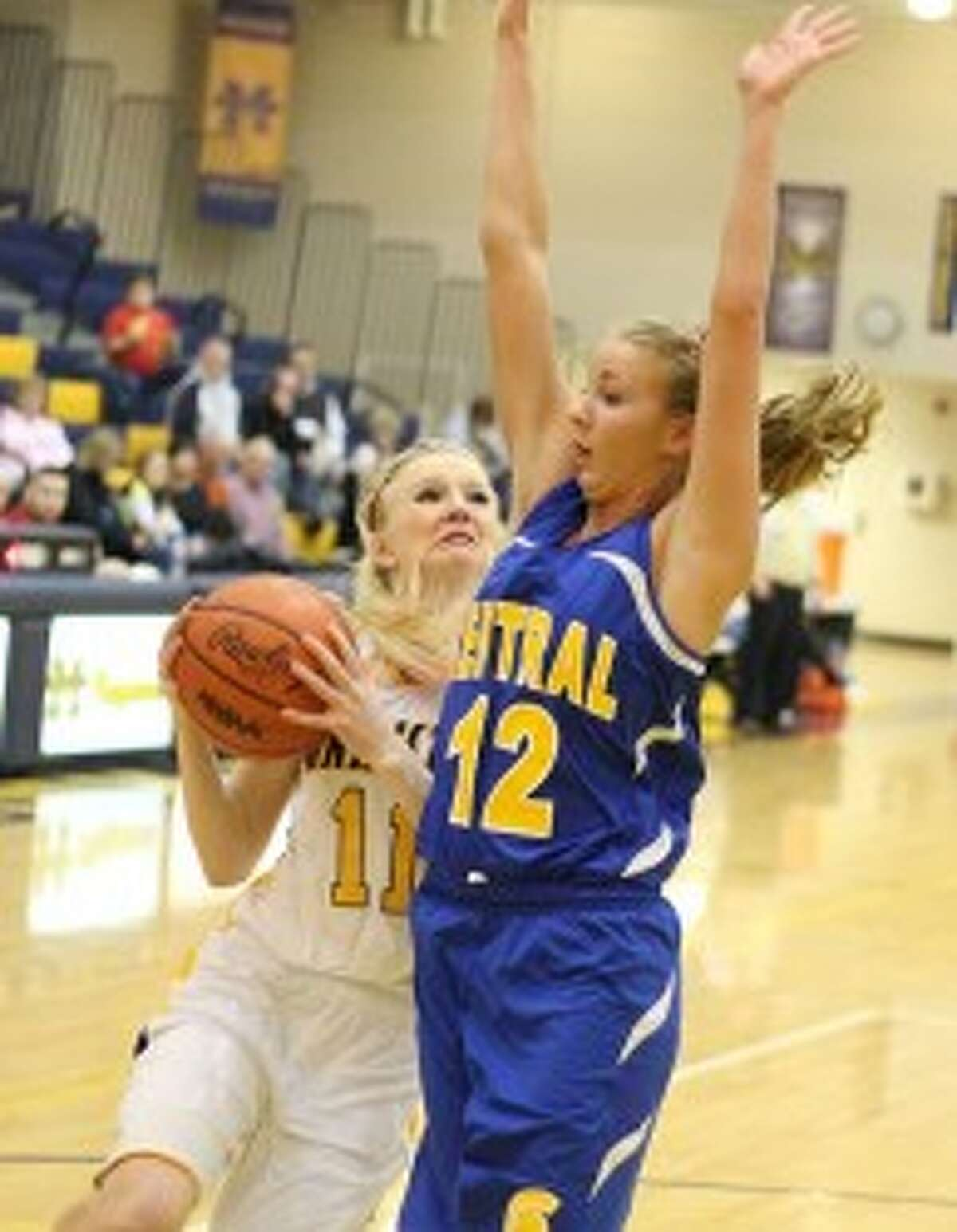 Manistee's Annie Fuller (11) drives to the basket against Mason County Central's Madison Geers during Monday's Class B district quarterfinal. Fuller and the Chippewas will host Benzie Central tonight. (Matt Wenzel/News Advocate)