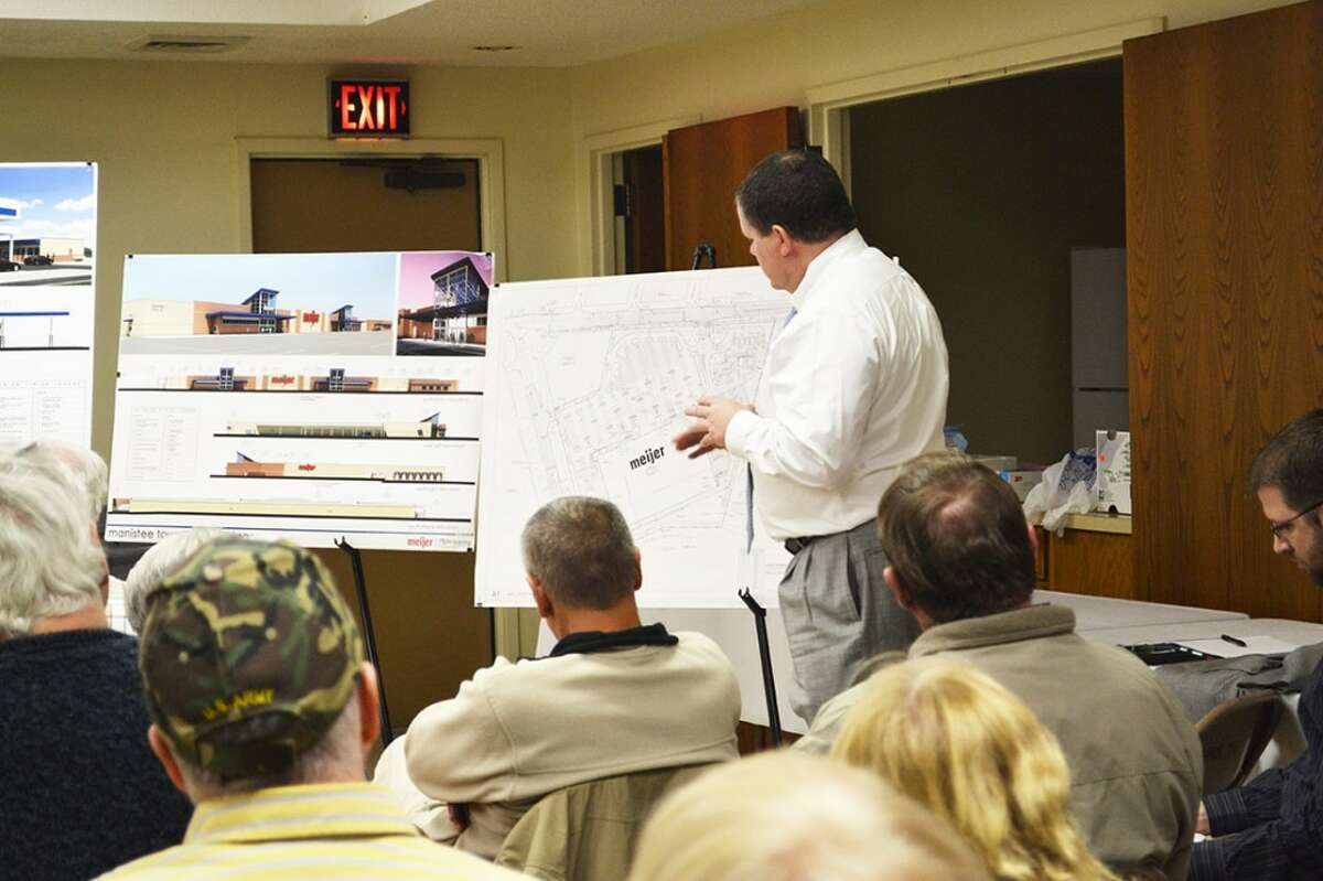Meijer real estate manager Bob Doran presents plans for the proposed box store to a Thursday night meeting of the Manistee Township Planning Commission. (Meg LeDuc/News Advocate)