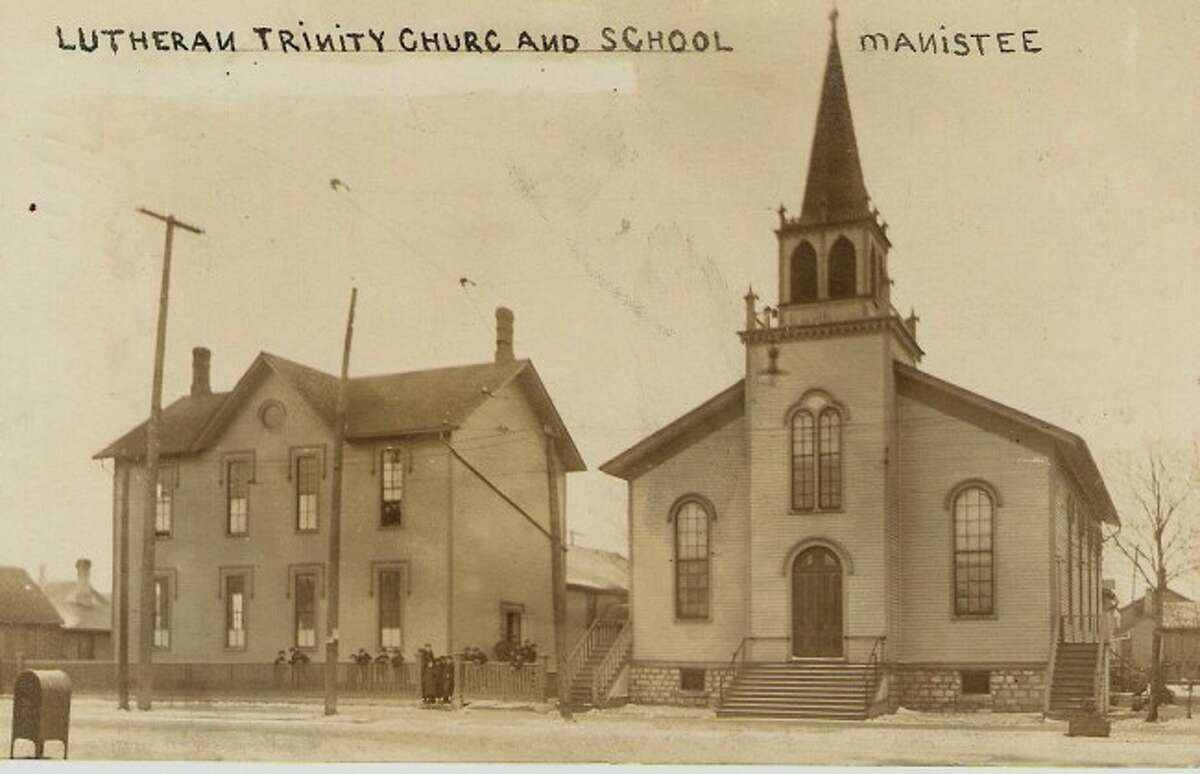 The Trinity Lutheran School and Church are shown in this early 1900 photograph. They were located at the present corner of First and Cypress streets.