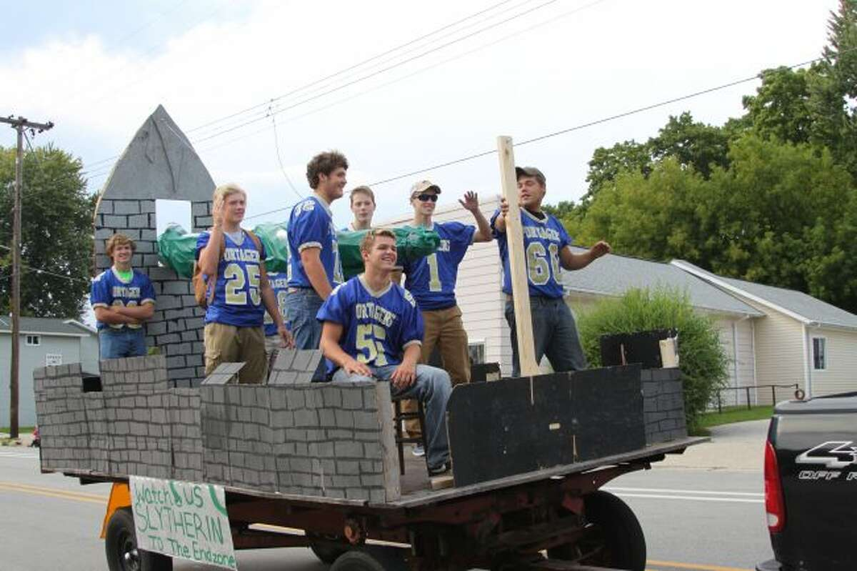 Members of the football team at Onekama take part in the Homecoming Parade.