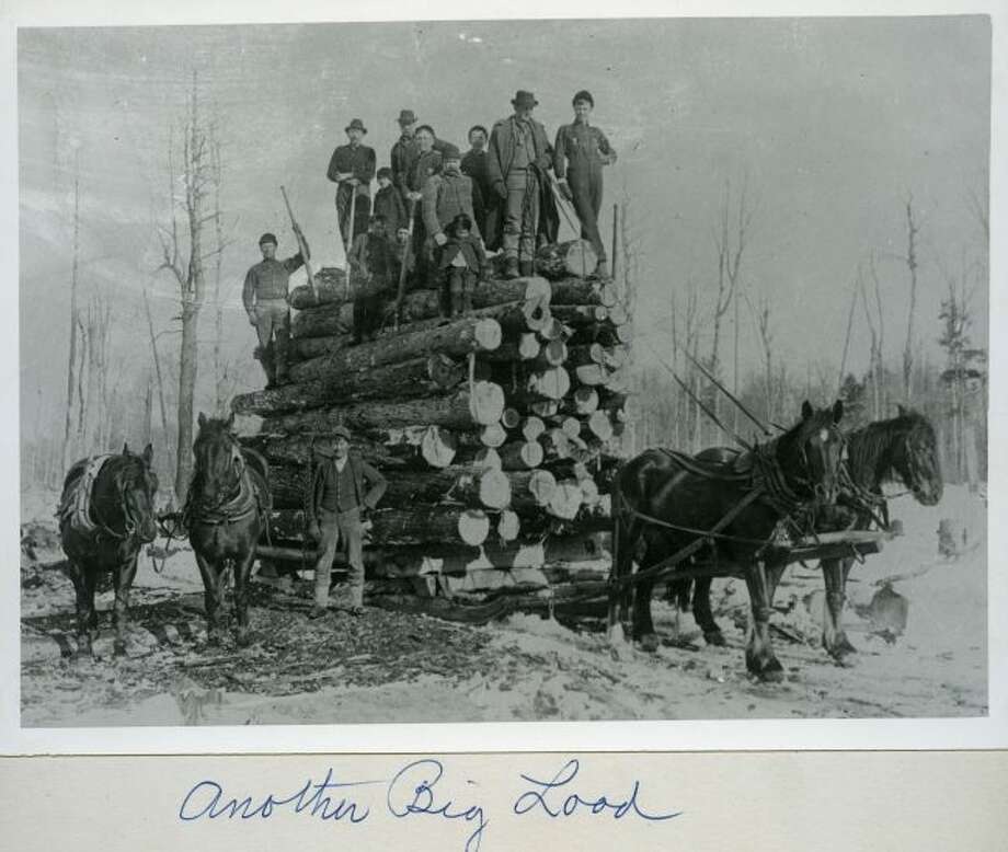 Another big load of logs gets ready to be hauled off the sawmill in this 1890s photograph.