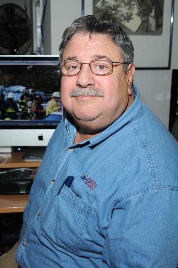 Dick Aarons, of Ridgefield, is a former Philadelpia newspaper police reporter and photographer who instructs police officers in crime scene photography. Photo: Lisa Weir / The News-Times