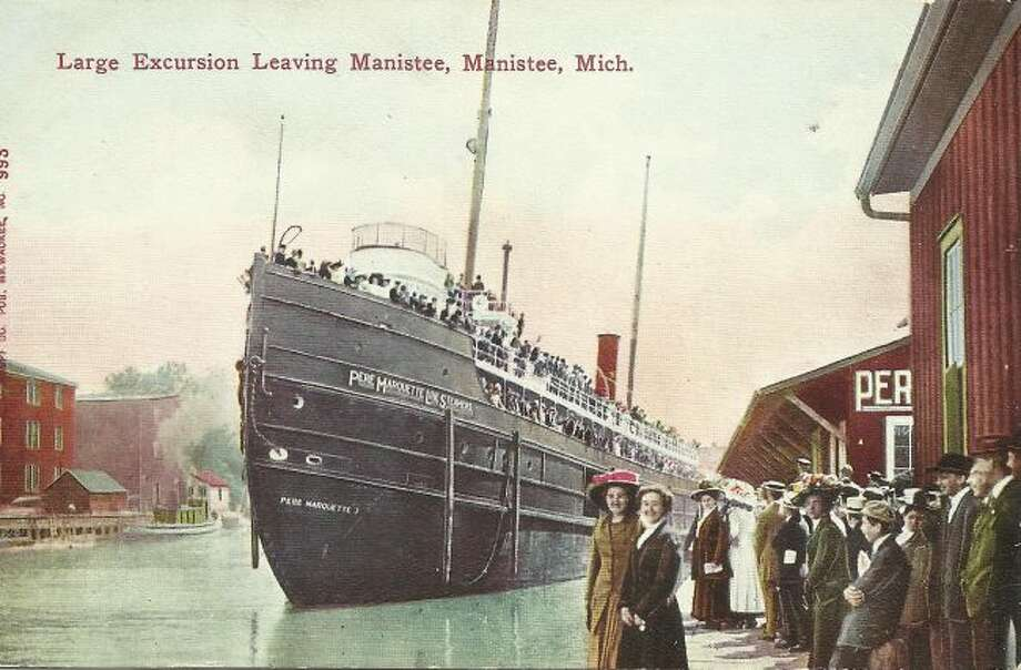 A large group of people showed up at the docks on to watch one of the Pere Marquette steams leaving the Manistee area with a load of passengers in the 1890s.
