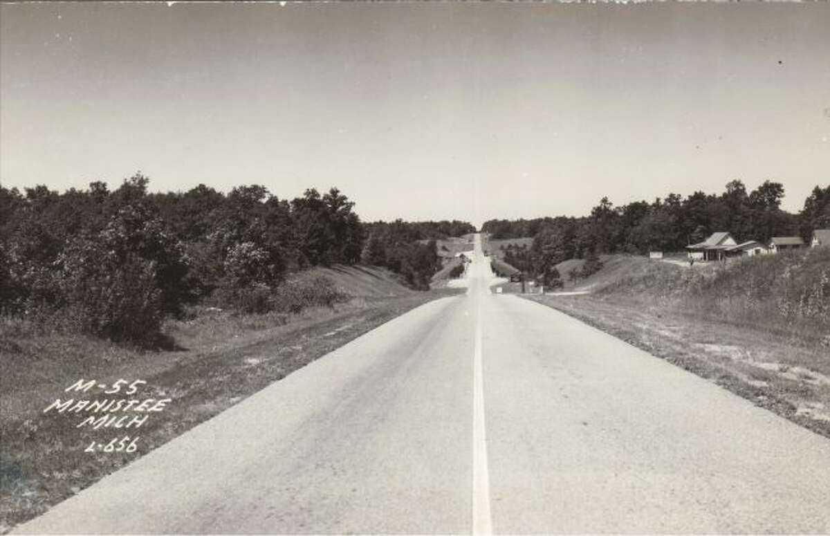 This late 1950s photograph shows the view looking down M 55 by Cooley Bridge.