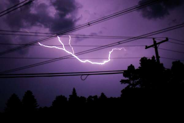Lightning fills the sky past power lines on Monday, July 29, 2019 from Duanesburg, N.Y. (Lori Van Buren/Times Union)