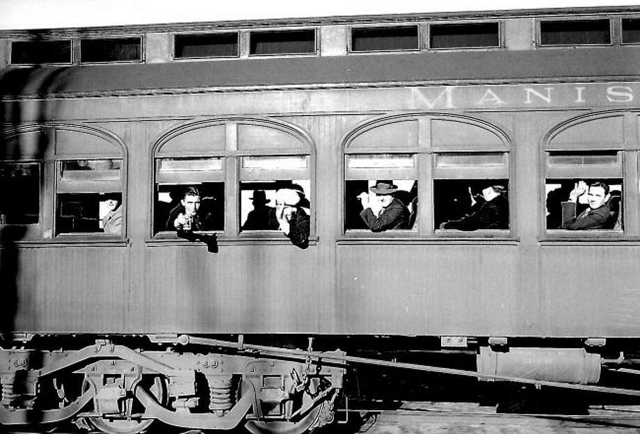 Passengers aboard an MN&E passenger train are read to leave the Manistee station in this 1930 photograph.
