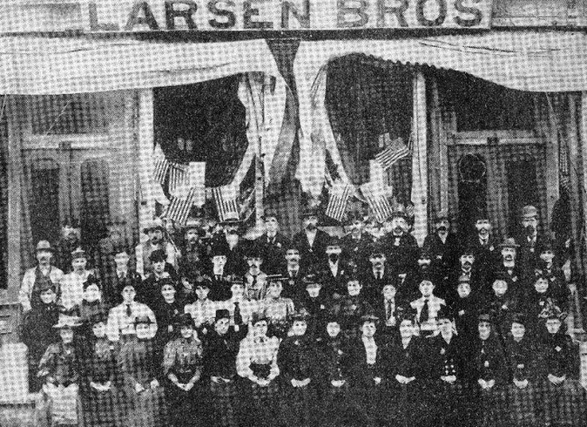The personnel of the Larsen Bros., Department Store, River and Greenbush streets are shown in theabove photo as they gathered in front of the store on July 4, 1895. The store was managed by F.C. Larsen.