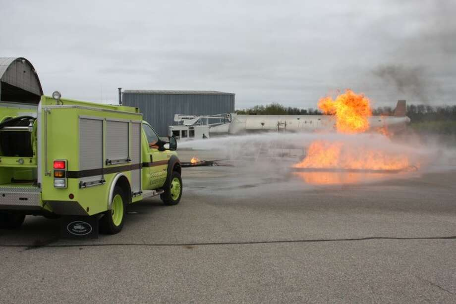 Manisstee Blacker Airport personnel took part in training on Saturday to handle a fire in an airplane.