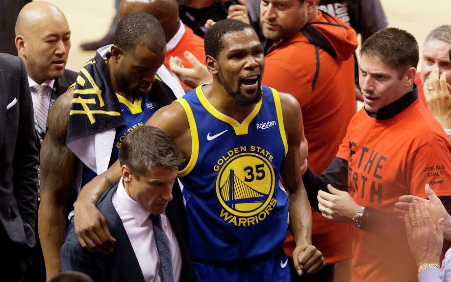 FILE - In this June 10, 2019, file photo, Golden State Warriors forward Kevin Durant (35) reacts as he leaves the court after sustaining an injury during first-half basketball action against the Toronto Raptors in Game 5 of the NBA Finals in Toronto. Durant is headed to the Brooklyn Nets, leaving the Warriors after three seasons. His decision was announced Sunday, June 30, 2019, at the start of the NBA free agency period on the Instagram page for The Boardroom, an online series looking at sports business produced by Durant and business partner Rich Kleiman. (Chris Young/The Canadian Press via AP, File) Photo: Chris Young, AP / The Canadian Press