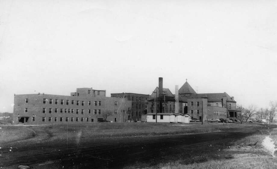 The Mercy Hospital in Manistee is shown in this 1950s picture with a new addition being added on to it.
