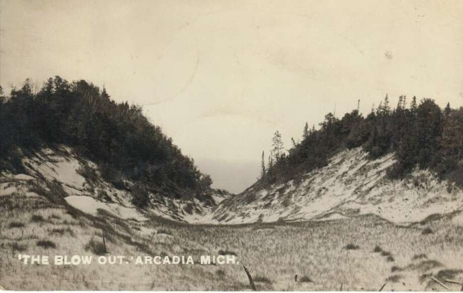 This 1930s scene shows a large blowout in the sand dunes near the Arcadia area.