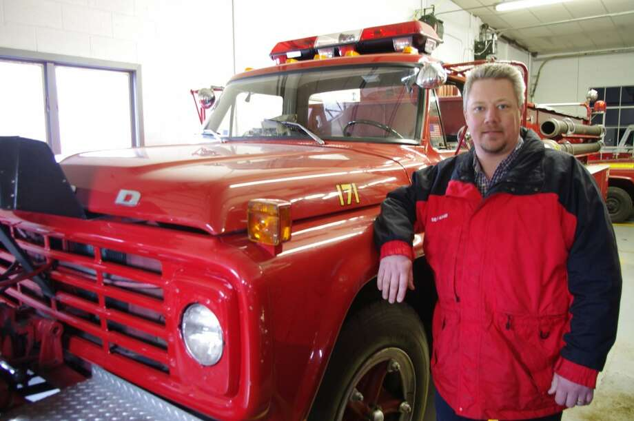 Sean Adams, Bear Lake Township fire chief, stands next to his department's 1978 fire truck -- the first piece of equipment that will be replaced if an August millage election is successful. (Dave Yarnell/News Advocate)