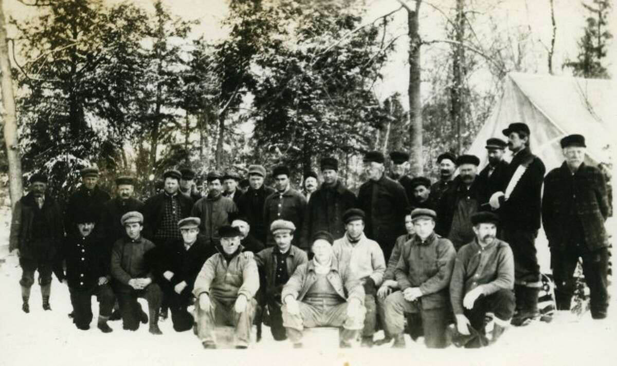 This group of lumberjacks pose for a group shot in their logging camp during the winter of 1895.