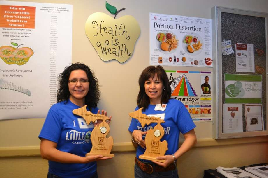 """Charmaine Stone (left) and Lynn Saunders were named """"Hometown Health Heroes"""" for their efforts in helping Little River Casino Resort employees lead healthier lifestyles. (Meg LeDuc/News Advocate)"""