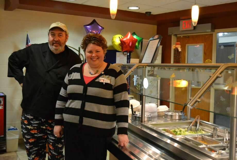 Courtney Johnson, food and nutrition services director at West Shore Medical Center, and Al Frye, chief operating officer of the Manistee Community Kitchen, stand in the cafeteria of WSMC. Last year, Johnson bought nearly 100 percent of the produce served at the hospital from local farmers. (Meg LeDuc/News Advocate)