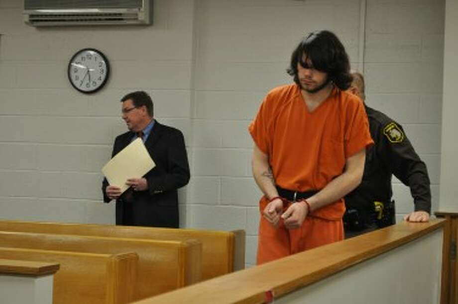 Toby Cook was arraigned on Thursday for the murder of Dennis Guenthardt.