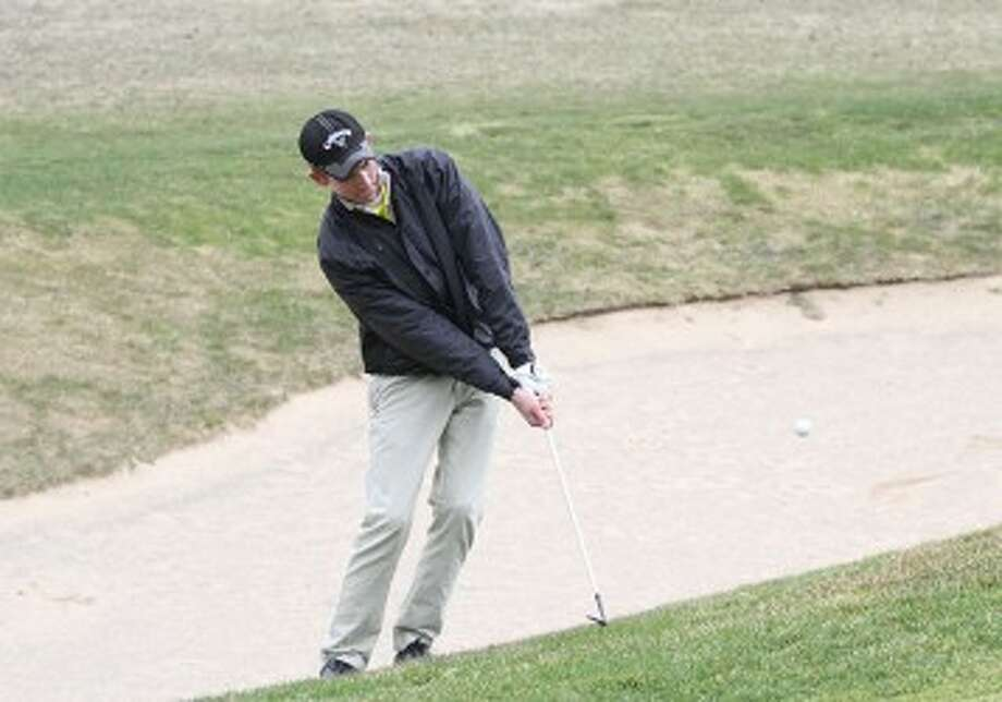 Manistee sophomore Matt Simmons chips from the side of the No. 8 green at Manistee National's Canthooke Valley during Friday's match. (Matt Wenzel/News Advocate)