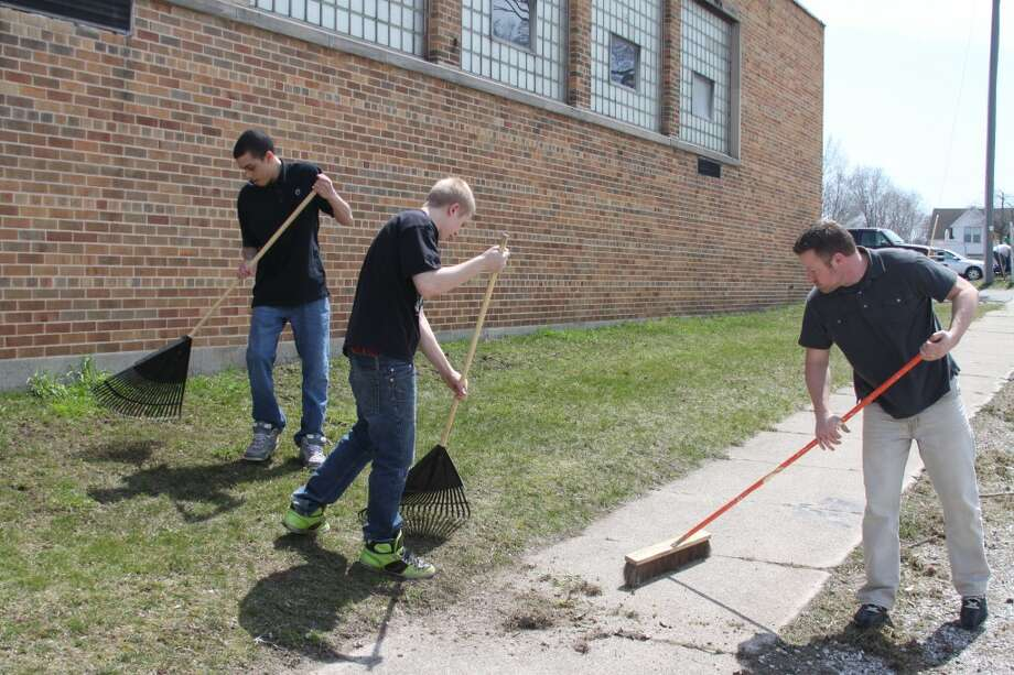The entire school at CASMAN Academy were busy on Monday afternoon cleaning up the school grounds.(Ken Grabowski/News Advocate)