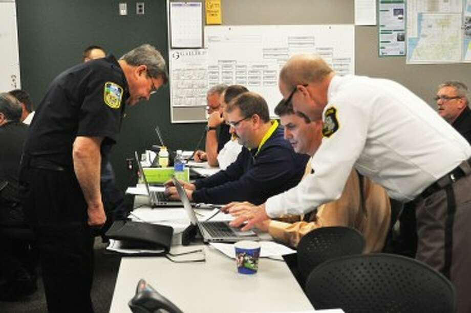 Manistee County Sheriff Dale Kowalkowski (right) works with undersheriff John O'Hagan to enter data into the Web emergency operations center during a drill on Thursday. The drill simulated an eight-month-long flu outbreak and was conducted at the Manistee County Sheriff's Office.