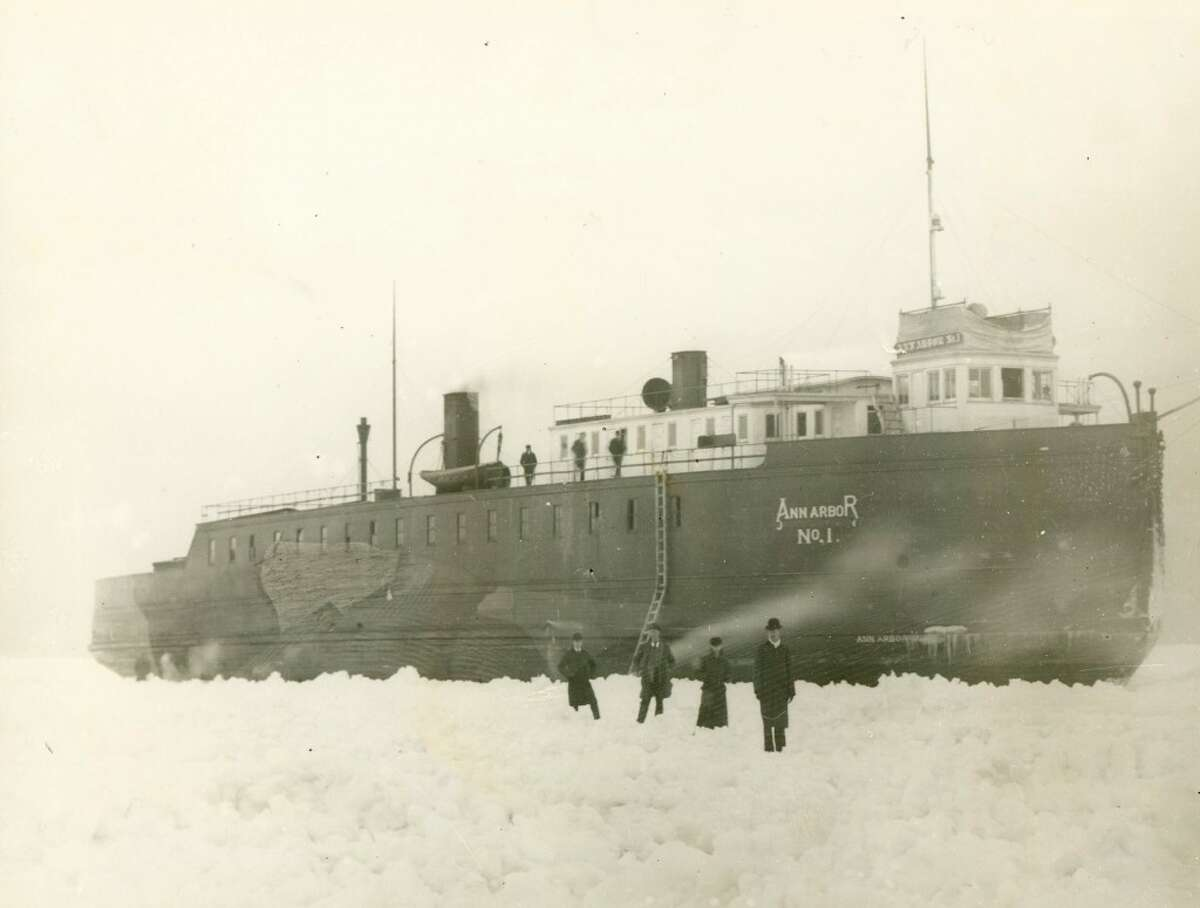 Passengers walk to the shore from the steamer Pere Marquette after it got stuck in the ice on the way into Manistee harbor in the early 1900s. (Courtesy Photo/Manistee County Historical Museum)