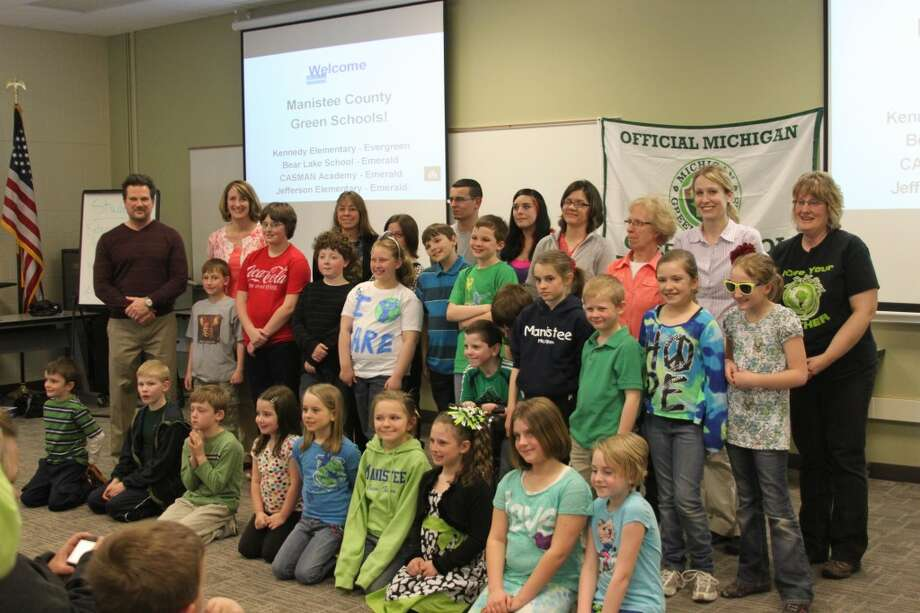 Students and teachers from area schools recognized in the 2013 Michigan Green Schools program gather for a group photo. Local schools winning that recognition were KennedyElementary, Jefferson Elementary, Bear lake Schools and Casman Alternative Academy. (Ken Grabowski/News Advocate)