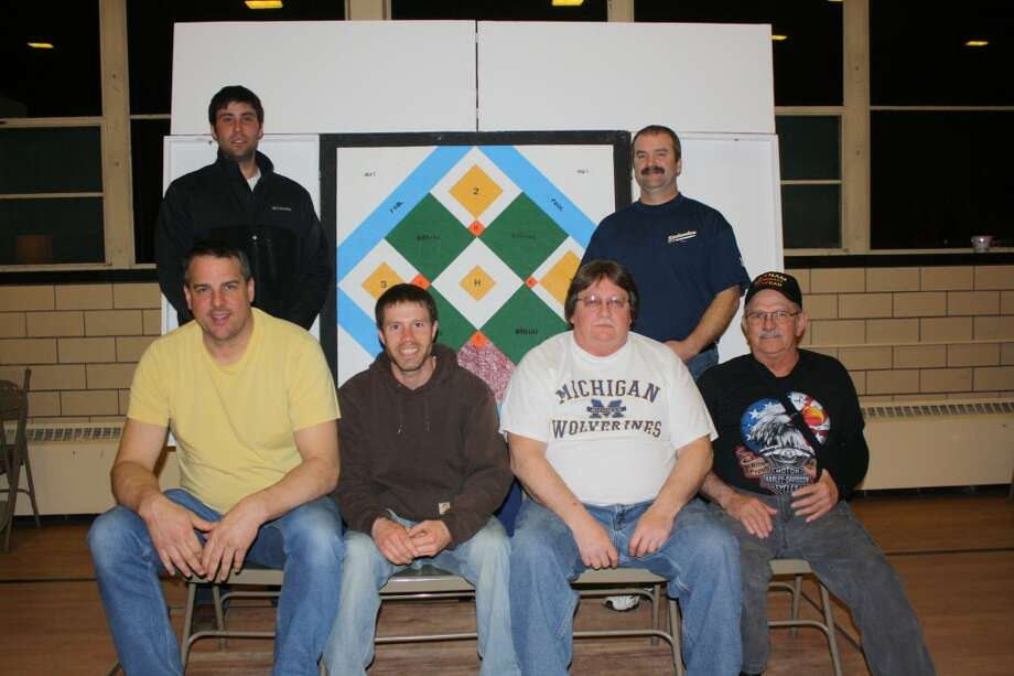 Team No. 1 from Trinity Lutheran Church of Onekama won the 2013 Manistee/Benzie County Churchmen's Dart Ball League tournament, defeating Good Shepherd 5-0 for the title. Members of the championship team are (seated from left to right) are Dan Gustad, Nick Jados, Doug Aultman, Dave Stamp (back row) Tyler Aultman and Greg Welch. (Courtesy Photo)