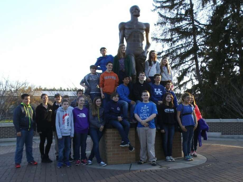 Members of the MCC Junior and Senior High School Science Olympiad Teams at MSU's Sparty Statue. The teams were competing at Michigan State University
