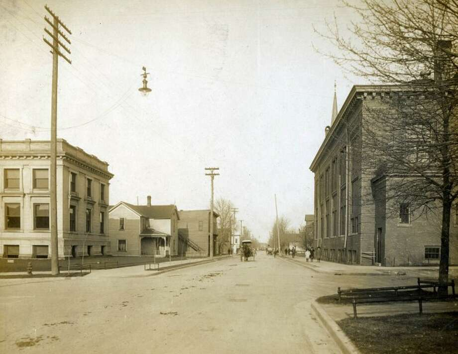 Looking east on the corner of First and Maple Streets circa early 1900s.