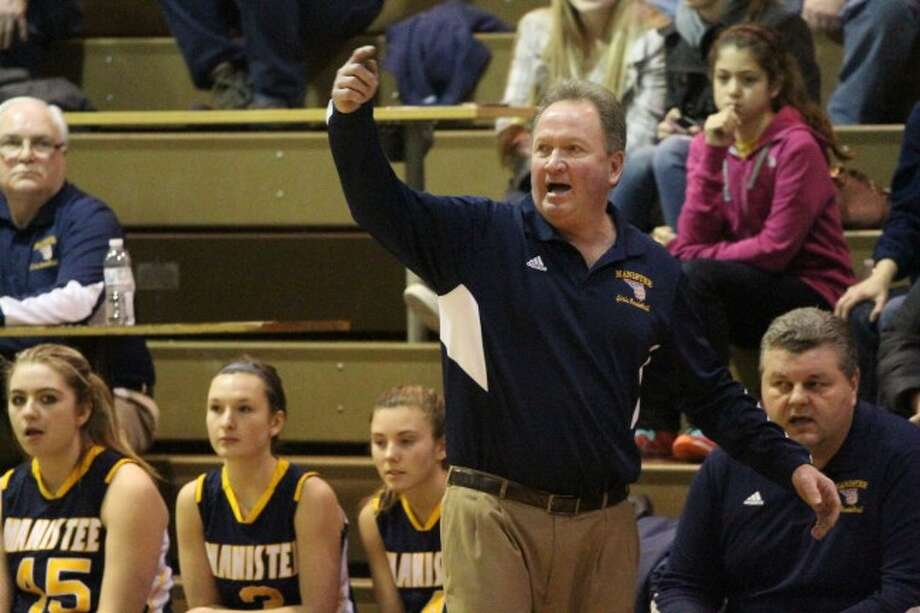 Longtime girls basketball coach Todd Erickson directing his charges at Manistee High School during the 2013-14 season.