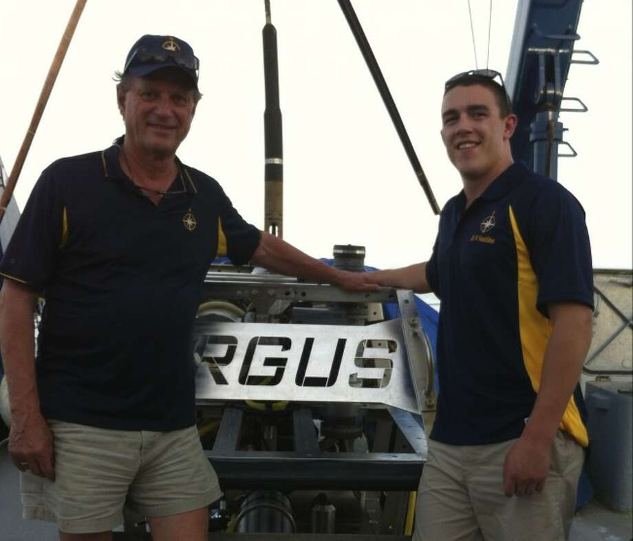 Noted shipwreck explorer Bob Ballard is shown with Benzie resident Nolan Salyer, a recent Coast Guard Academy graduate with the robot Argus. Salyer is the son of Dan and Kay Salyer and he spent a six-week internship with Ballard working on a project in the Gulf of Mexico to locate a World War II submarine. The experience was filmed for 60 Minutes.
