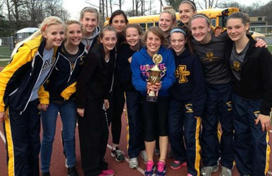 The Manistee girls track and field team poses with its trophy for being the top Division 3 team at the Ken Bell Invitational on Friday at Traverse City Central. (Courtesy photo)