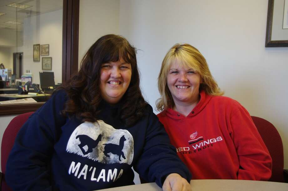 Sisters Denise Malama (left) and Nicole Hudson still find things to smile about after a month -- and more -- of family tragedies. (Dave Yarnell/News Advocate)