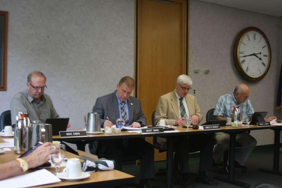 Members of the West Shore Community College Board of Trustees discuss faculty award.